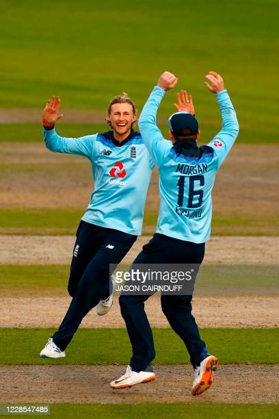 England's Joe Root celebrates taking the wicket of Australia's batsman Mitchell Marsh during the one-day international cricket match between England...