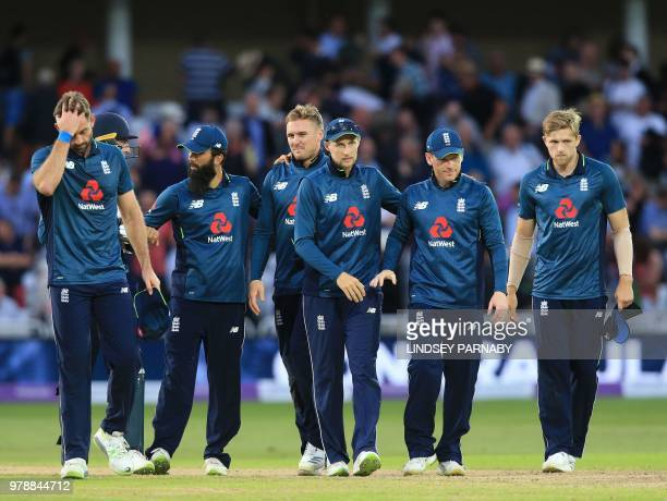 England's Joe Root celebrates victory with teammates after the third OneDay International cricket match between England and Australia at Trent Bridge...