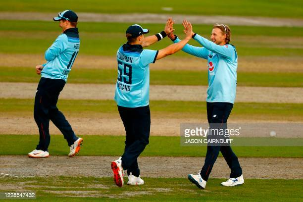 England's Joe Root celebrates with Tom Curran after taking the wicket of Australia's batsman Mitchell Marsh during the one-day international cricket...