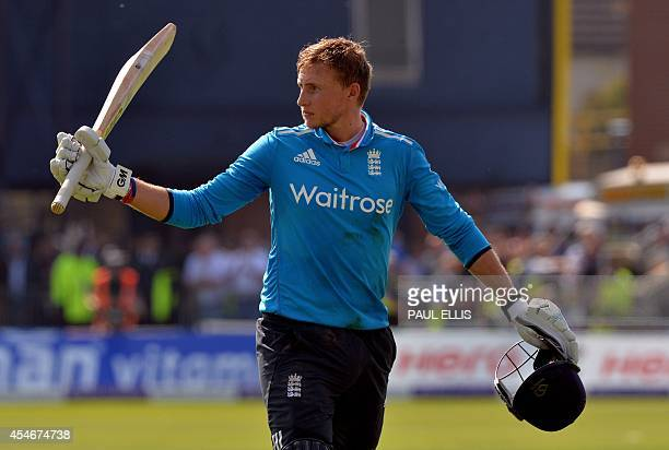 England's Joe Root gestures to the crowd as he walks off having lost his wicket for 113 during the fifth oneday international cricket match between...