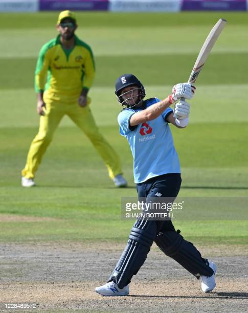 England's Joe Root hits a six during the one-day international cricket match between England and Australia at Old Trafford in Manchester on September...
