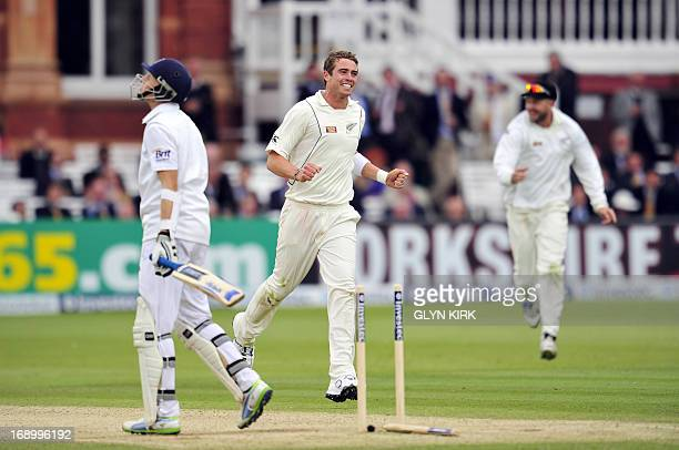 England's Joe Root leaves the pitch after being bowled out by New Zealand's Tim Southee for 71 runs during the third day of the first International...
