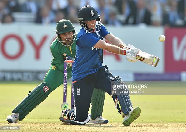 England's Joe Root plays a shot watches by Pakistan's wicketkeeper Sarfraz Ahmed during play in the second one day international cricket match...