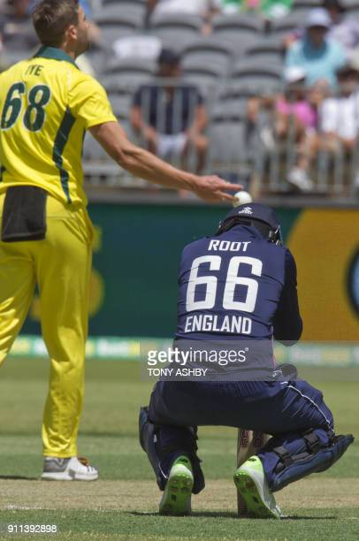 England's Joe Root receives a blow from a delivery from Australia's Andrew Tye during the fifth oneday international cricket match between England...