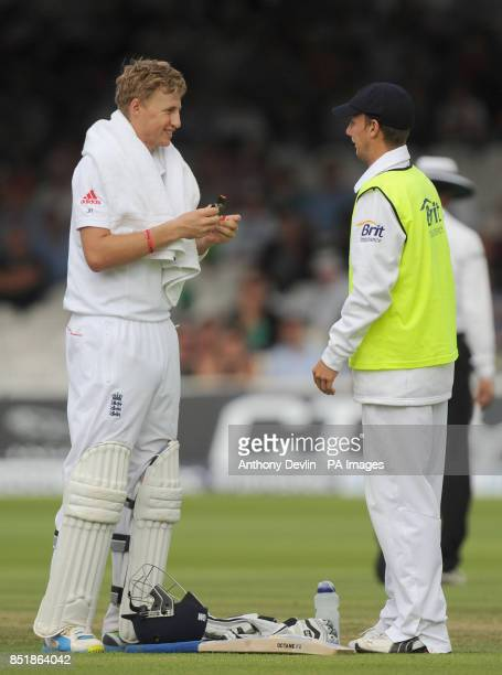 England's Joe Root shares a laugh with brother Billy Root England's 12th Man on day three of the Second Investec Ashes Test at Lord's Cricket Ground...