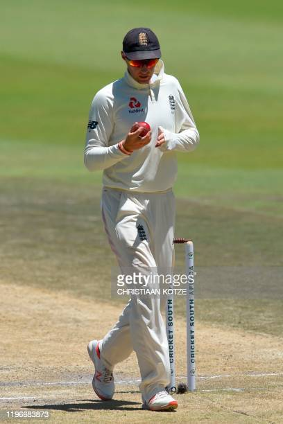 England's Joe Root shines the ball during the fourth day of the fourth Test cricket match between South Africa and England at the Wanderers Stadium...