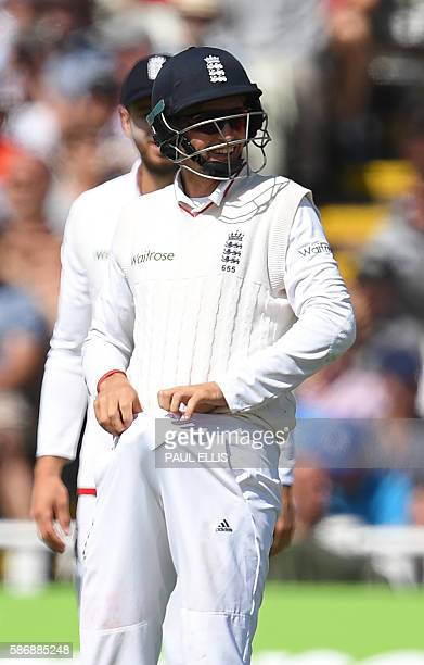 England's Joe Root smiles as he positions a protective 'box' during play on the final day of the third test cricket match between England and...