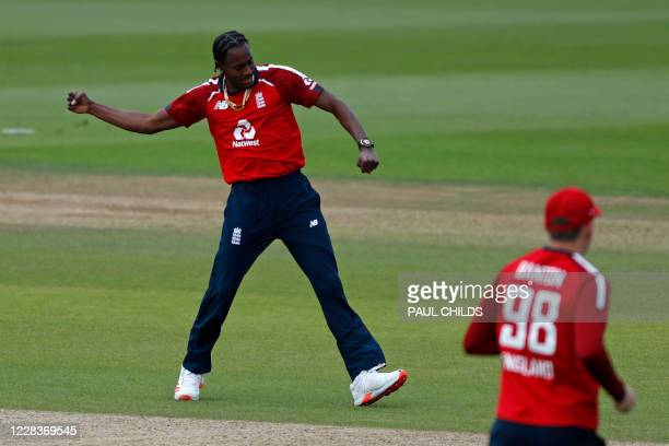 England's Jofra Archer celebrates after taking the wicket of Australia's David Warner in the first over of the international Twenty20 cricket match...