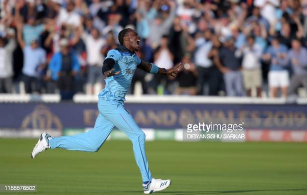 TOPSHOT England's Jofra Archer celebrates after victory in the 2019 Cricket World Cup final between England and New Zealand at Lord's Cricket Ground...