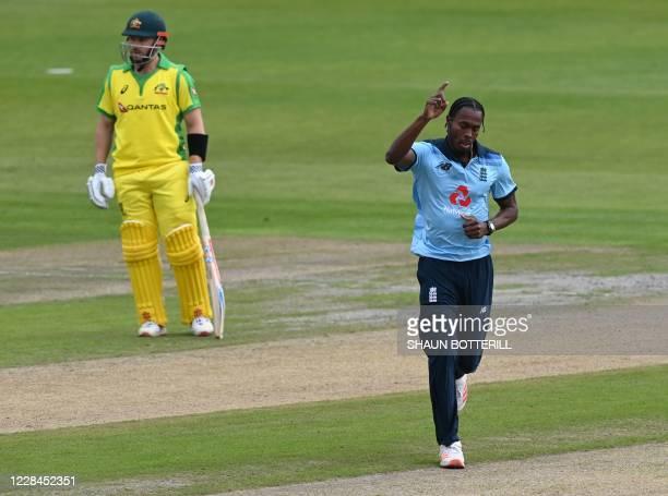 England's Jofra Archer celebrates dismissing Australia's David Warner during the one-day international cricket match between England and Australia at...