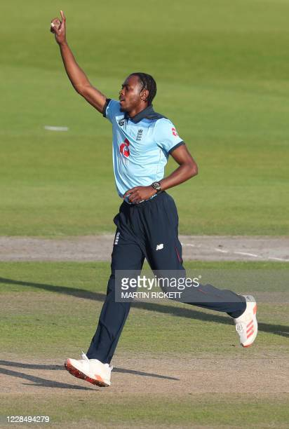 England's Jofra Archer celebrates dismissing Australia's David Warner for six runs during the one-day international cricket match between England and...