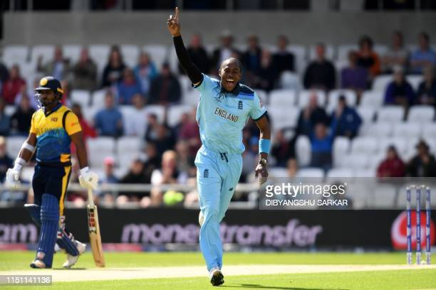 England's Jofra Archer celebrates taking the wicket of Sri Lanka's captain Dimuth Karunaratne for one run during the 2019 Cricket World Cup group...