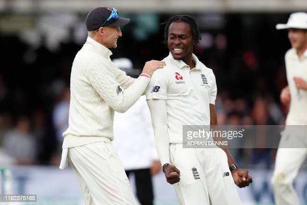England's Jofra Archer celebrates with England's captain Joe Root after taking the wicket of Australia's Usman Khawaja during play on the fifth day...