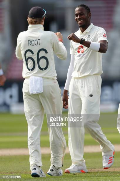 England's Jofra Archer celebrates with England's Joe Root after taking the wicket of Pakistan's Mohammad Abbas first ball, during play on the second...