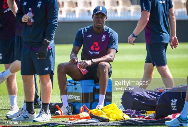 England's Jofra Archer sits on a cooler box as he has a drink during a team training session ahead of the second cricket Test between England and New...