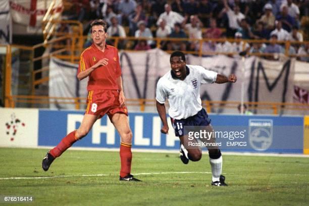 England's John Barnes wheels away in celebration following David Platt's goal near the end of extra time. Belgium's Franky Van Der Elst can't believe...