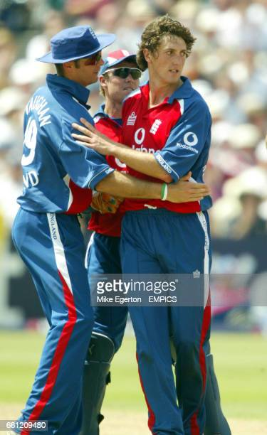 England's John Lewis is congratulated by Michael vaughan after claiming the wicket of Australia's Michael Clarke