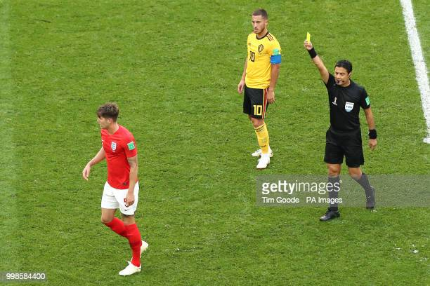 England's John Stones is shown a yellow card by Referee Alireza Faghani after a foul on Belgium's Eden Hazard during the FIFA World Cup third place...