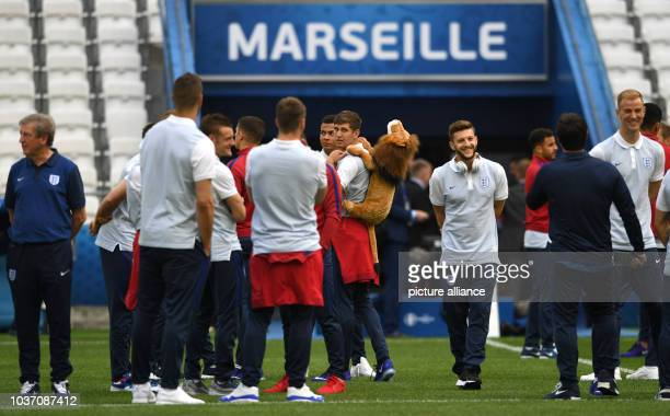 England's John Stones with a Lion mascot on his bag Adam Lallana goalkeeper Joe Hart and coach Roy Hodgson inspect the Stade Velodrome in Marseille...