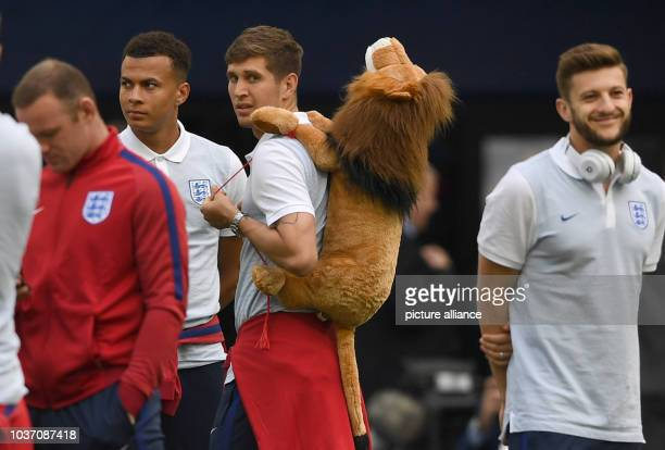 England's John Stones with a Lion mascot on his bag Dele Alli Wayne Rooney and Adam Lallana inspect the Stade Velodrome in Marseille France 10 June...