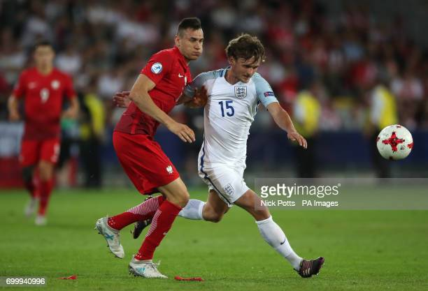 England's John Swift and Poland's Jaroslaw Jach battle for the ball during the UEFA European Under21 Championship Group A match at the Kolporter...