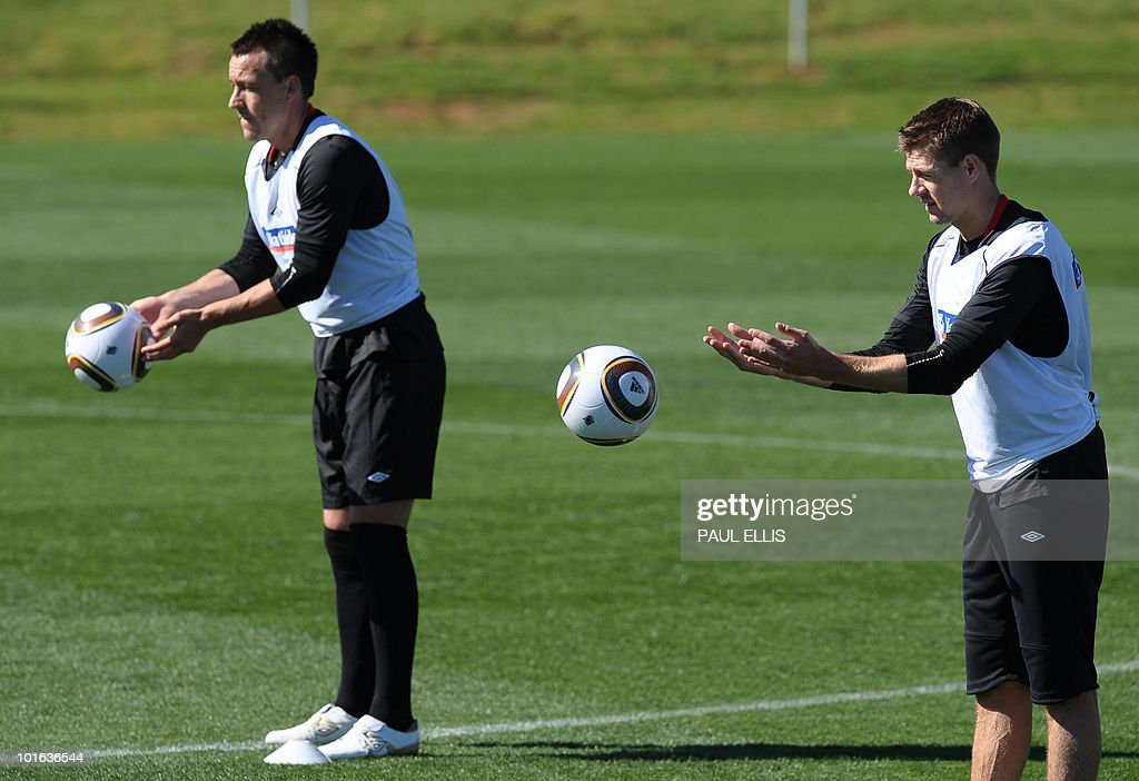 England's John Terry (L) and Steven Gerrard throw balls during a training session at the Royal Bafokeng Sports Campus near Rustenburg on June 5, 2010.
