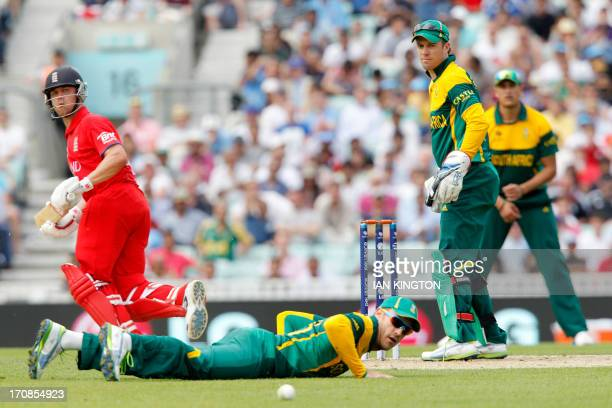 England's Johnathan Trott runs between the wickets as South African captain AB Devilliers looks on during the One Day International ICC Champions...