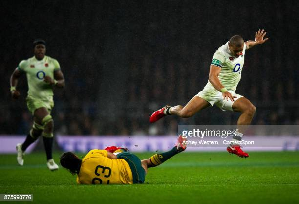 England's Jonathan Joseph evades Karmichael Hunt during the Old Mutual Wealth Series Autumn International match between England and Australia at...
