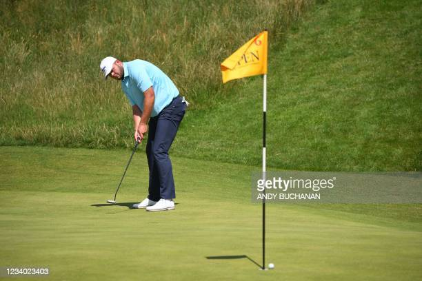 England's Jonathan Thomson watches his put just miss the hole on the 6th green during his third round on day 3 of The 149th British Open Golf...