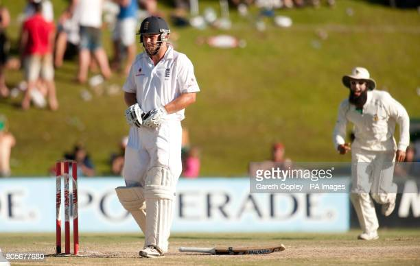 England's Jonathan Trott edges the ball to be caught out by South Africa's AB deVilliers during the First Test at the SuperSport Park Centurion South...