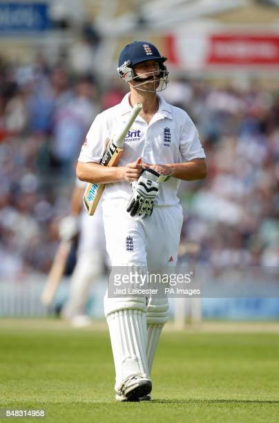 England's Jonathan Trott walks dejected off the field after getting out for 71 to Morne Morkel during the Investec first test match at the Kia Oval...