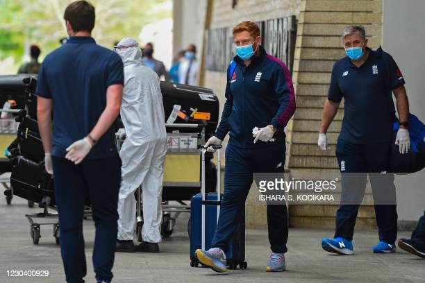 Englands Jonny Bairstow and coach Chris Silverwood arrive at the Rajapaksa international airport in Mattala on January 3 as England's cricket team...