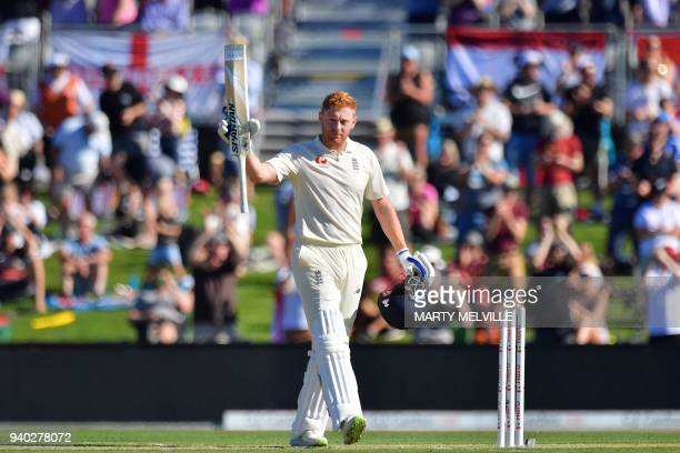 England's Jonny Bairstow celebrates 100 runs during day two of the second cricket Test match between New Zealand and England at Hagley Oval in...