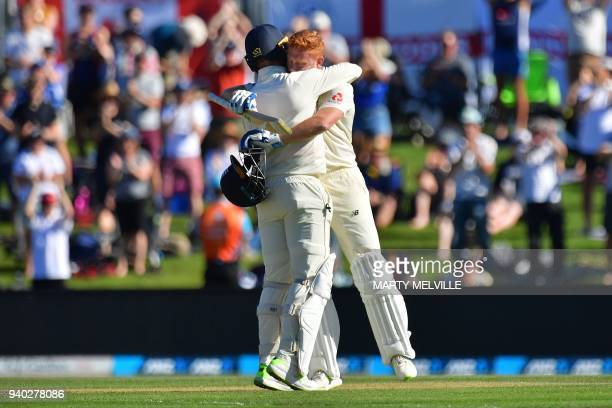 England's Jonny Bairstow celebrates 100 runs with teammate Jack Leach during day two of the second cricket Test match between New Zealand and England...
