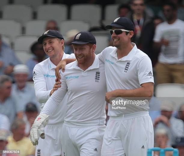 England's Jonny Bairstow celebrates his catch with England's Alastair Cook during Day Three of the Fourth Investec Test Match between England and...