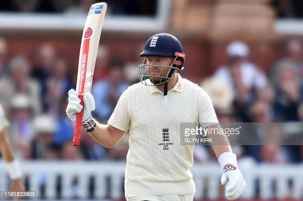 England's Jonny Bairstow celebrates his halfcentury on the second day of the second Ashes cricket Test match between England and Australia at Lord's...