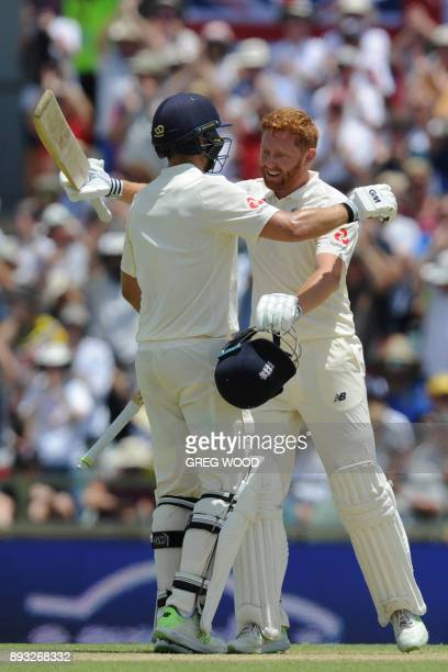 England's Jonny Bairstow celebrates reaching his century with Dawid Malan on day two of the third Ashes cricket Test match between Australia and...