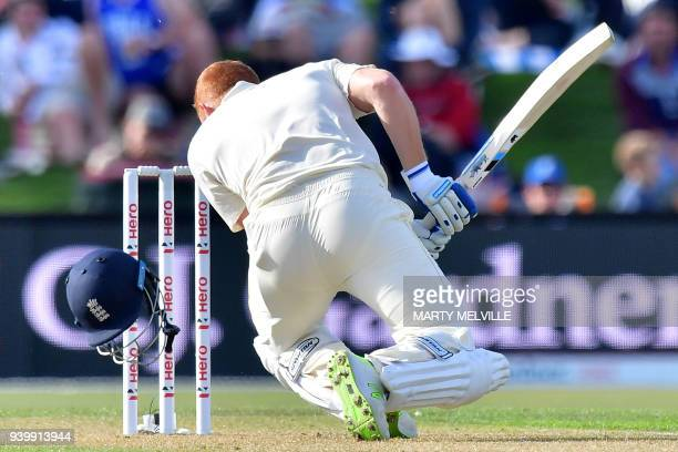 England's Jonny Bairstow has his helmet knocked off by a bouncer during day one of the second cricket Test match between New Zealand and England at...