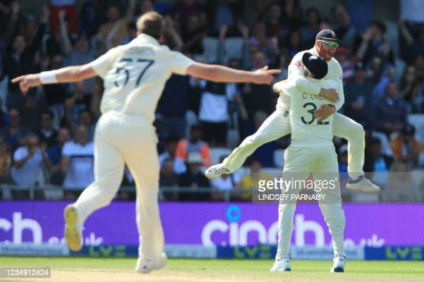 England's Jonny Bairstow leaps into the arms of England's Craig Overton after Overton takes the catch to dismiss India's Rishabh Pant off the bowling...