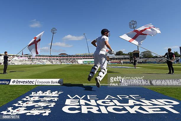 England's Jonny Bairstow runs out at the start of play on the final day of the third test cricket match between England and Pakistan at Edgbaston in...
