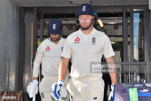 England's Jonny Bairstow walks out to the field with teammate Jack Leach during day two of the second cricket Test match between New Zealand and...
