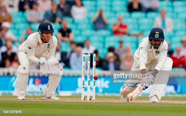 England's Jonny Bairstow watches as India's K L Rahul plays a shot during play on the final day of the fifth Test cricket match between England and...