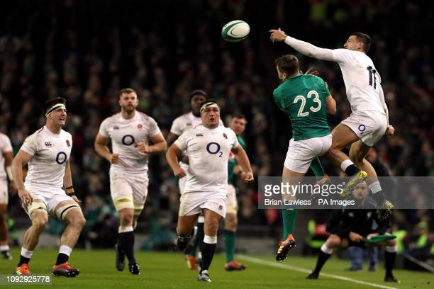 England's Jonny May and Ireland's Jordan Larmour battle for the ball in the air during the Guinness Six Nations match at the Aviva Stadium Dublin