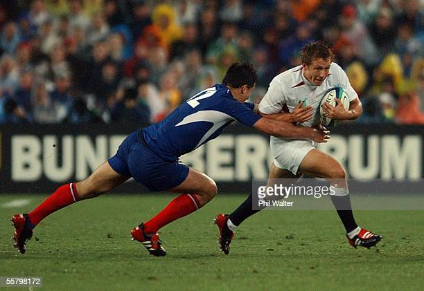 England's Jonny Wilkinson breaks the tackle of France's Yannick Jauzion in the Rugby World Cup semifinal match played at Telstra Stadium...