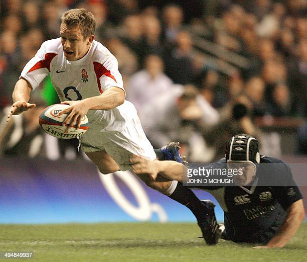 England's Jonny Wilkinson scores a try against Scotland despite Dougie Hall's tackle during their Six Nation rugby game at Twickenham Stadium London...