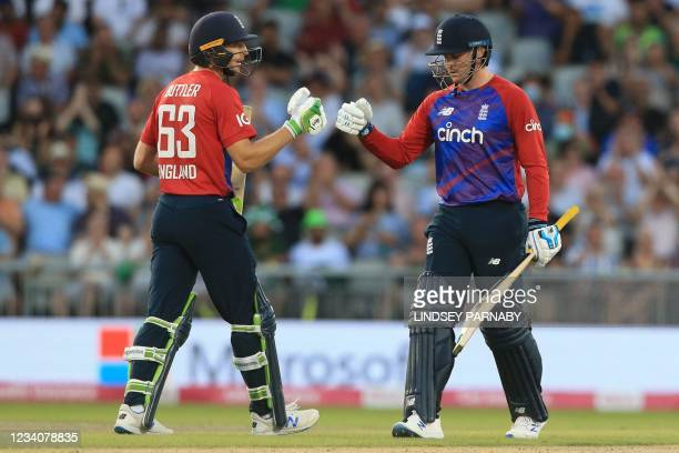 England's Jos Buttler and England's Jason Roy touch gloves during the third T20 international cricket match between England and Pakistan at Old...