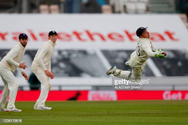 England's Jos Buttler catches out Pakistan's Shaheen Afridi off the bowling of England's Stuart Broad on the third day of the third Test cricket...