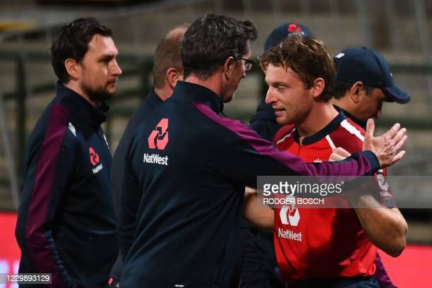 England's Jos Buttler celebrates with teammates after their victory over South Africa during the third T20 international cricket match between South...