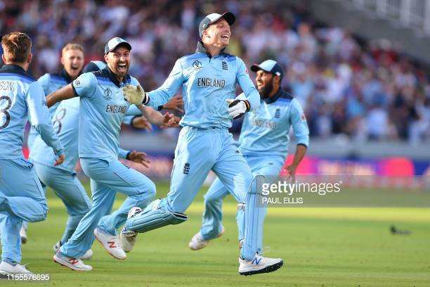 England's Jos Buttler celebrates with teammates after they win the super over to win the 2019 Cricket World Cup final between England and New Zealand...