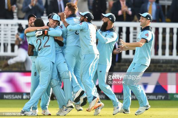 TOPSHOT England's Jos Buttler celebrates with teammates after they win the super over to win the 2019 Cricket World Cup final between England and New...